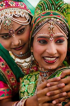 Portrait of a female peacock dance performer dressed in her finest silk and jewels, during the annual Elephant Festival, held every March in the Pink City of Jaipur.