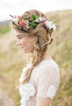 Brides.com: . Braids within a braid, wispy locks, and a gorgeous flower crown would make any boho girl's dreams come true.