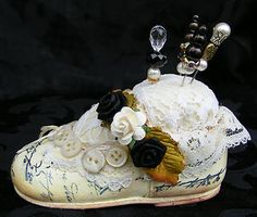 Altered baby shoe pin cushion painted and stamped