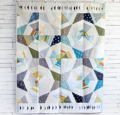 I've got my eye on those loose geese!  Robert Kaufman Octagon Shimmer by Jennifer Sampou Quilt - White