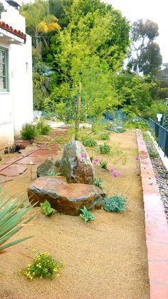 Beautiful front yard with bounders, decomposed granite and drought tolerent plant material