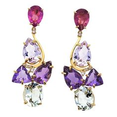 """VIANNA- 18K Gold, Amethyst, Pink Tourmaline Earrings. There's nothing shy about these yellow Gold earrings from Brazilian designer Vianna's Splash collection, which form a brilliant mosaic of gemstones  in a curvy setting that includes an array of vibrant gemstones, including what the designer calls """"savage-pink"""" Tourmaline, Amethyst and Prasiolite, a green Quartz. The earrings come with posts. $2,450.00"""