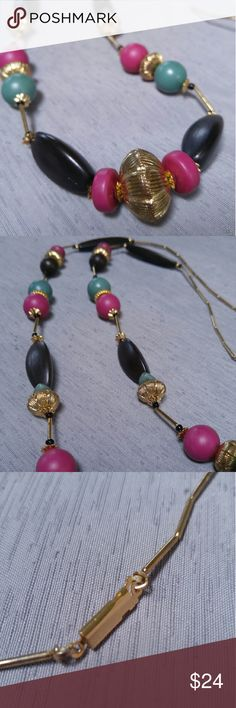 "Vintage Beaded Necklace Gorgeous vintage necklace in excellent condition! Features a pattern of gold, black, pink, and teal beads. Clasp is a tab insert box clasp. Length is 18"". All beads are plastic except thin gold ones are metal. Please ask any and all questions. No trades. Make a reasonable offer. Thanks! Vintage Jewelry Necklaces"