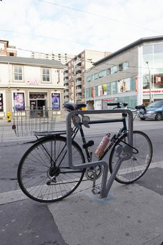 Toronto, running circles around NYC on the design of cool bike racks: Queen-West-Bike-Racks-3