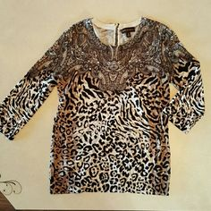 Leopard Multi print sweater Very thin sweater material. 3/4 length arms. Ribbed look at bottom of shirt. 1/4 zipper on back neck line. Worn only once. Dana Buchman Tops