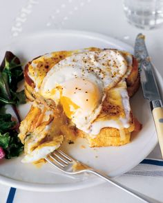 A bistro lunch reimagined for breakfast: A sandwich of dill and smoked salmon is topped with bechamel sauce, Comte cheese, and a fried egg.