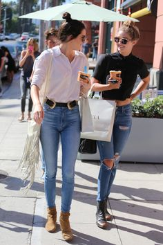 I usually hate Kendall Jenner's personal style but I LOVE her look here. Almost 80s with the best, high waisted jeans, and oversized white shirt yet somehow modern. Im also LOVING Gigi's polo--almost a punk vibe i am getting from it. All in all, both ladies look effortlessly fresh and cool.