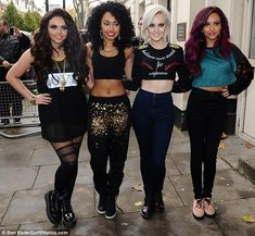 Look behind you! Little Mix's Jesy Nelson hits a bum note in exposing shorts as…
