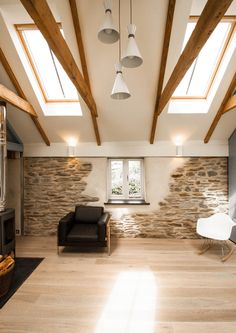 Refurbished stone walls and timber beams, Porth Cottage by Bradley Van Der Straeten Architects