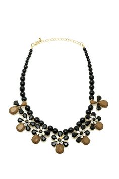 Feminine statement necklace with a strand of black beads accompanied by floral detail.   Black Flower Drop Necklace by Blossom Boutique. Accessories - Jewelry - Necklaces - Statement Necklaces South Shore, Boston, Massachusetts