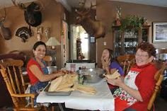 Image result for family making tamales