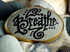 BREATHE Stone. Lettering is black, built up with layers of water-resistant glaze ink. The word is encircled with 18k gold leafing paint. LoveFromCapeCod on Etys. Sold