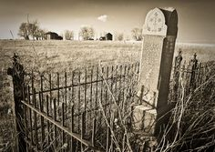 Immortal Home.  by James B. Wheeler    Found this old cemetery in north central Missouri this past weekend on a photography trip with Rodney Harvey. This small fenced in family plot is located out in the middle of a field partway up a long driveway that leads to an abandoned farm. Very cool location, something I never see up my way in central Iowa.