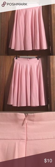 Pink skater skirt This is such a fun skirt! Very flattering, high waist with a flowy skirt! Light weight. Classy enough for work but enough sass for a date night! Size XL, fits size 12. Worn only a couple of times, EUC!! Skirts A-Line or Full