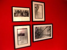Black and white photographs look great against the red wall