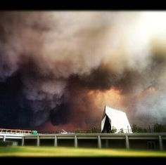 Colorado Spring's Waldo Canyon Fire is to the south and west of the coveted Air Force Academy. This picture of the Academy's chapel is a stark photo of the danger that looms ahead.