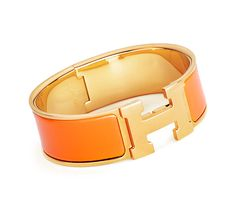"Clic-Clac H  Hermes wide bracelet. Orange enamel. Gold plated hardware, 2.25"" diameter, 7.5"" circumference, 1"" wide."