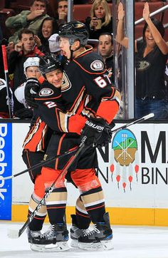 Kevin Bieksa and Rickard Rakell of the Anaheim Ducks celebrate a first period goal during the game against the Arizona Coyotes on November 2016 at Honda Center in Anaheim, California. Ducks Hockey, Anaheim California, First Period, Arizona Coyotes, Anaheim Ducks, Montreal, Nhl, Sassy, Sick