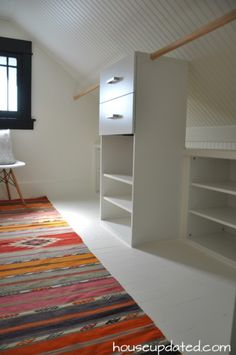 Two-layered closet in a room with a very sloped ceiling.  Made using Ikea shelves.