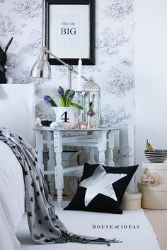 Wallpaper, nightside table styling, grays and whites. <3