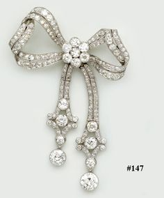 Diamond and platinum bow brooch. This large and beautiful bow brooch has wonderful sweeping curves and generous diamonds giving the brooch a great sense of movement. Beautiful old European cut diamonds.