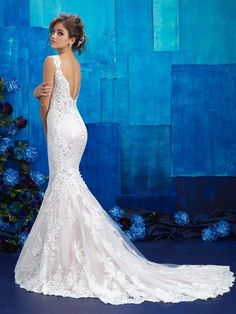 Style: 9419    This lace gown features a slightly flared skirt along with a scalloped lace back.            FABRIC:  Lace, Charmeuse, and English Net   ...