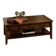 """4-drawer coffee table in warm cherry with an open bottom shelf.  Product: Coffee tableConstruction Material: Veneers and hardwoodColor: Warm cherryFeatures:  Four drawersOpen bottom shelf   French dovetail constructionDimensions: 20"""" H x 52"""" W x 26"""" DCleaning and Care: Wipe with soft cloth as needed"""