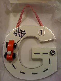 Hand decorated 20cm wooden letter for lovely little boys who love racing!