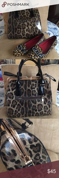 """Gorgeous unusual bag Gorgeous unusual bag with animal print Patton design gold hardware black Patton handles closure is the straps on the side rundown A gold guide to open and close very unusual one zipper pocket on outside 2 zipper pockets on the inside 2 slit pockets on the inside very large middle opening fully lined dimensions are12"""" deep 10 1/2 """" across  6"""" flat bottom with gold protective feet Bags Satchels"""