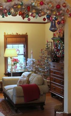 love the garland with lots of vintage ornaments