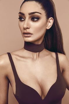 The Skyline choker is the perfect addition to any piece from our basics  line, made from the same luxe, stretch fabric, trial it with anything from  bodysuits to dresses, to our form fitting crops. Get creative and explore  the options.  Available in Nude, Black, White,Chocolate & Slate.  - One size fits all
