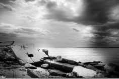 """""""Hole and Cracks"""" Picture-A-Day (PAD n.2831) Black and white seascape and clouds buy prints here: http://www.dangrabbit.com/photography/pad/05_10_holeandcracks . . . . .  Fineart photography - B&W rocky shore - by Amy DangRabbit Medina"""