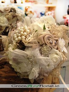 Green Art Your Dublin Florist - Style: Bridal Heirloom Brooch Bouquet, medium size, compact design, including hand made satin roses and silver brooches Bridal Brooch Bouquet, Brooch Bouquets, Brooches, Satin Roses, Silver Brooch, Green Art, Light Beige, Artificial Flowers, Dublin