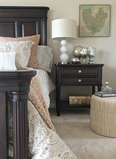 Looking to lighten up your dark bedroom furniture? Try adding new paisley bedding in soft beiges, taupes, grays and light blues paired with shimmery mercury glass accessories, a leather ottoman and subtle coastal accent from HomeGoods. Sweet Dreams! Happy By Design Sponsored Post.