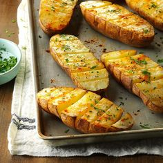 Scored Potatoes Recipe -These well-seasoned baked potatoes are a fun alternative to plain baked potatoes. It's easy to help yourself to just the amount you want, too, since the potato halves are scored into sections. — Barbara Wheeler, Sparks Glencoe, Maryland