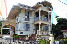 """Hofileńa Ancestral Home, Silay.  """"This ancestral house is home to one of the finest paintings by Filipino artists. Currently, it is still an occupied residence of the charismatic owner, Ramon Hofileńa. Antiques of the Hofileńa family are seen inside the house along with their old dining sets and family portraits and wood printing in Negros was first contained in this house."""""""