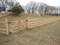 Just a simple wood fencing, could paint it a good color to match your property!