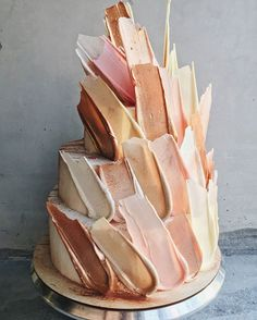 "You may remember the wedding cake post we did on mirror cakes?  Well, this is another new trend that also comes from Russia and Kalabasa is the confectionery behind these ""chocolate feather"" or ""brushstroke"" cakes.  We thought they were unique with a cool factor that would leave your guests in awe, so we thought we'd share.  After …"