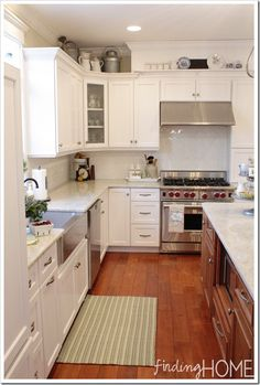 A builder's grade kitchen becomes bright and white to bring summer sunshine in all year round.  #BHGSummer