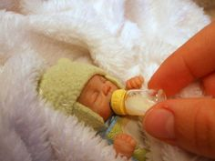 Miniatures, Doll Art, tiny baby with bottle.
