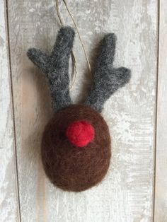 Needle felted wool reindeer ornament measuring approximately 3 inches, including the antlers. Jute string attached for easy hanging. This item is