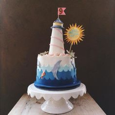 Ocean Themed 9Th Birthday Cake Ocean Themed 9Th Birthday Cake Vanilla cake with vanilla SMBC. Modeling chocolate waves. Gum paste sea creatures, shells, sun. Rice cereal... #featured-cakes #leannew #cakecentral