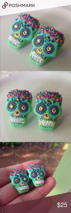 "Gorgeous sparkly sugar skull stud earrings ✨These lovely sugar skull earrings are made from resin. Adorned with tons of rhinestones for lots of sparkle;very eye catching! Colors include: mint green, yellow, pink, teal and iridescent white. Skulls measure approximately 1"". Stud backings that are nickel and lead free. Handmade by me & brand new. It took me quite some time to make these so please no low offers. Bundle & save 15% on 3+ items✨ Tags:Day of the dead,pastel…"