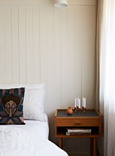little details : pillow, tiny candles // A RENOVATED 1960′S COTTAGE IN MELBOURNE | THE STYLE FILES