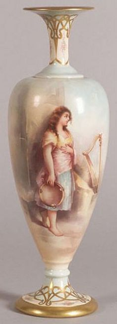 America, A hand-painted American Belleek porcelain vase, Lenox, early 20th century, slender neck over elongated egg-shaped body and trumpet foot, painted with a gypsy girl with tambourine and harp, neck and foot with gilt strapwork offset with rose sprays. Circa 1905-1930