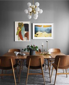 Stylish lighting for homes. Dining room idea with colorful framed pictures, large wood table and grey walls. Dining room idea with colorful framed pictures, large wood table and grey walls. Decoration Inspiration, Dining Room Inspiration, Decor Ideas, Decorating Ideas, Design Inspiration, Neutral Decorating, Decorating Websites, Interior Inspiration, Interior Decorating