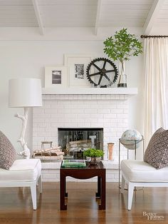 The updated living room features clean, contemporary style. Because the fireplace and mantel were in good condition, all they needed was a fresh coat of white paint to blend with the style of the room. The brick on the fireplace provides subtle texture to the otherwise white room and furnishings. Expert Tip: The easiest (and most inexpensive) way to revive a boring brick fireplace is with paint./