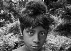 Sebastião Salgado. S) images | The tribe nurtures orphaned animals as pets; they share their hammocks ...