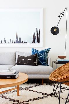 Basically the perfect California cool living room with layers, textures, and a muted palette punched with indigo and blue
