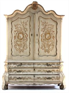 A 19th Century Provincial Dutch Bombe Armoire.  The arched cornice centered by a gilt C scroll carving above two paneled doors and a lower case with four shaped drawers and boldly scrolled front feet. The whole with later cream colored paint decoration in the Rococo taste. The wood is pine.